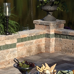 Custom patio rock wall with contrasting trim